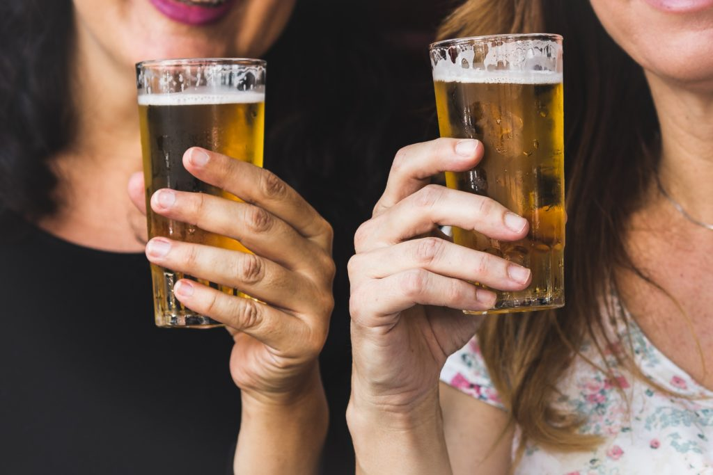 two women holding beer